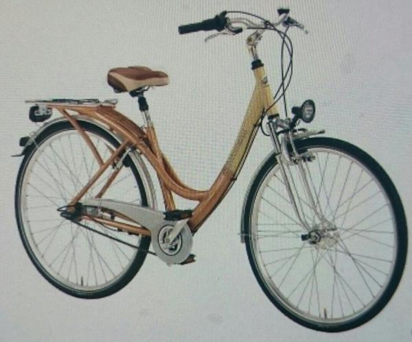 das fahrrad hat 7 g ng r cktritt ist am sattel gefedert. Black Bedroom Furniture Sets. Home Design Ideas