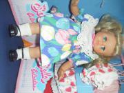 Puppe mit Koffer