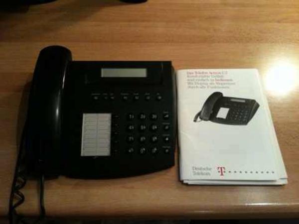 Telefon Actron C2 mit Beschreibung